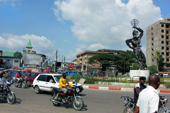 In the centre of Douala, Cameroun. One of the central places in Douala, Cameroun people circulating, motos and cars, daylight Royalty Free Stock Images