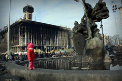 The centre of Kiev. Little girl on Independence square of Kiev after revolution Stock Photo