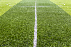 Centre soccer green field background Stock Images