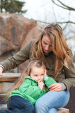 Centred little girl with mother waiting Royalty Free Stock Image
