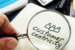 Centricity do cliente escrito à mão em uma almofada de nota fotografia de stock