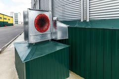 Centrifugal fans for silo ventilation. Large steel silos. Centrifugal fans for silo ventilation. The modern granary Stock Images