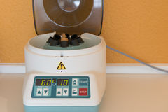 Centrifuge as medical equipment for treatment of liquids.  royalty free stock image