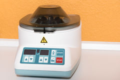 Centrifuge as medical equipment for treatment of liquids.  royalty free stock photography