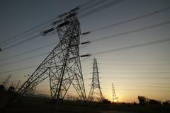 Centro de distribuição do poder com por do sol Fotos de Stock Royalty Free