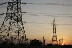 Centro de distribuição do poder com por do sol Imagem de Stock