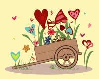 Centro de flores de corazones coloridos en un handcar Fotos de archivo libres de regalías