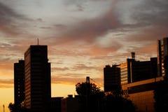 Centro de la ciudad en la salida del sol Imagen de archivo libre de regalías