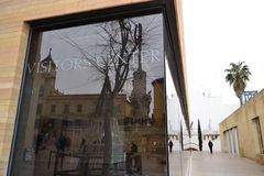 Centro de visitantes. Reflections of the Triumph of San Rafael through Crystal visitor center of Cordoba, Spain, in a very cloudy morning Stock Photos