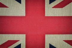 Centro della bandiera di britannici su vecchia struttura della tela Fotografia Stock