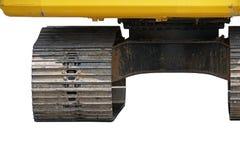 Centro della ruota sinistra del trattore a cingoli (fuoco selezionato) di trac giallo Immagini Stock