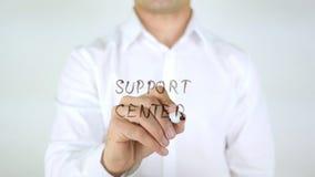 Centro di sostegno, scrittura dell'uomo sul vetro Fotografia Stock