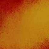 Centro goldtone del fondo arancio astratto e colori caldi arancione scuro del confine Fotografie Stock