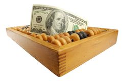 Cents dollars et vieille calculatrice Photo stock