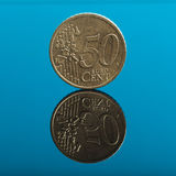 50 cents, Euro money coin on blue with reflection Royalty Free Stock Images