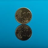 10 cents, Euro money coin on blue with reflection Royalty Free Stock Photo