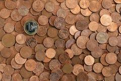 Cents, Münzen und ein Euro Lizenzfreie Stockfotografie