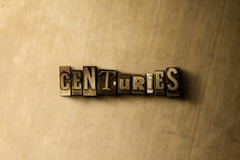 CENTURIES - close-up of grungy vintage typeset word on metal backdrop Royalty Free Stock Photos