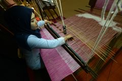 Traditional Songket weaving. Centuries-old art of textile weaving, the songket is one of Terengganu's top products whose weavers are considered to be the royalty free stock images
