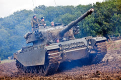 Centurion Tank. BELTRING, UK - JULY 19: A preserved ex-British army Centurion tank negotiates deep mud in the parade ground at the War & Peace show on July 19 Stock Image