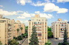 20 Century's tall living buildings in bright sunlight. Ness Ziona, Israel-May 21, 2017: Block of 20 Century's 8-story buildings without sun stock image
