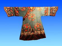 A century ago, Chinese silk court dress. Hangzhou China silk museum exhibits Royalty Free Stock Image