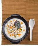 Century egg & pork porridge rice gruel serve. Porridge, century egg & pork Porridge (congee) served in claypot Stock Images