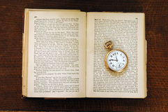 Century Old Book and Pocket Watch. 100 year old book with old pocket watch Stock Images