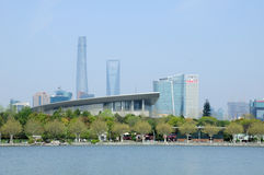 Century Park and Lujiazui skyline. A lake in Century park and the lujiazui skyline in the background including the Shanghai tower and IFC building Royalty Free Stock Photo