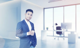 CEO asiatico nel suo ufficio fotografia stock