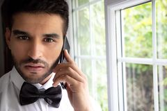 CEO, businessman wearing tuxedo talks on phone stock photo