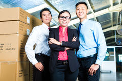 CEO and Businessmen in a warehouse Royalty Free Stock Photography