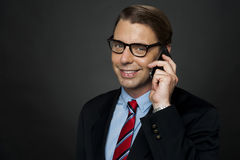 CEO communicating with his business clients. Over a phone call Royalty Free Stock Image