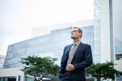 CEO of company. Proud confident CEO of company standing outside office building stock photography