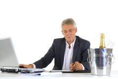 CEO con los succes en la oficina Imagen de archivo libre de regalías