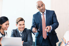 CEO explaining his vision in business meeting Stock Photo