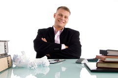 Ceo with folded hands in an office. The ceo with folded hands in an office Royalty Free Stock Photos