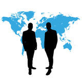 CEO in front of world map Stock Photo