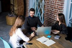 CEO having interview with new employees sitting in office royalty free stock photo
