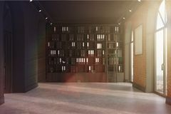 CEO office, bookcase and poster toned. CEO office with brick and black walls, a concrete floor, tall windows and a framed poster. 3d rendering mock up toned Royalty Free Stock Photo
