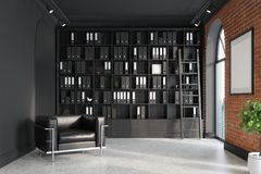 CEO office, bookcase, armchair, ladder. CEO office with brick and black walls, a concrete floor, tall windows and a framed poster. A large armchair is standing Royalty Free Stock Photos