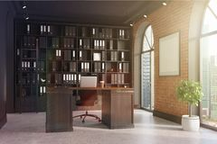 CEO office, bookcase and table toned. CEO office with brick and black walls, a concrete floor, tall windows and a framed poster. A large table with a laptop is Stock Images