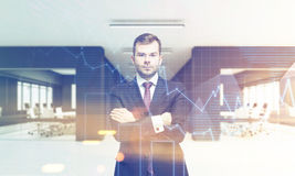 CEO in office with two conference rooms and graphs Stock Image