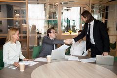 CEO shaking hand of male worker congratulating with job promotio royalty free stock images