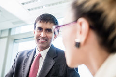 CEO smiling at his secretary in office Royalty Free Stock Images