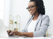 Ceo Writing Business Emails On Laptop In Office. Ceo Writing Business Emails On Laptop, Sitting On Workplace In Office royalty free stock photography