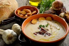 Cep soup. With olive oil  and slice toast bread on bowl Stock Image