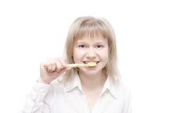 Cepillado de dientes Fotos de archivo libres de regalías