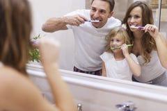 Cepillado de nuestros dientes Imagen de archivo libre de regalías