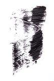 Cepille el strok de la sombra negra del rimel en blanco Imagen de archivo